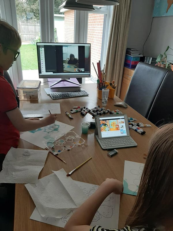 rainy day kids at the kitchen table having a distance learning art lesson with support materials printed on the Epson EcoTank ET-7700