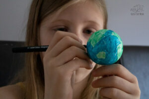 annotating the globe with the continents and oceans on