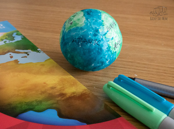 contients and oceans of the world annotated on a DIY Globe for hands-on geography unit study