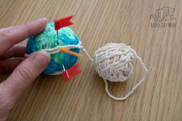 marking the equator and tropics diy globe using string and flag pins
