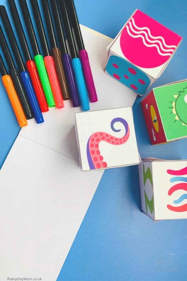 ready to play the monster drawing game, some felt pens and the printed monster body part cubes