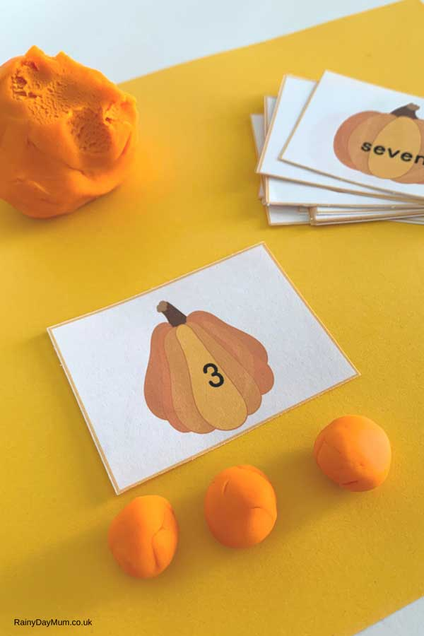 playdough pumpkins made to match the number cards