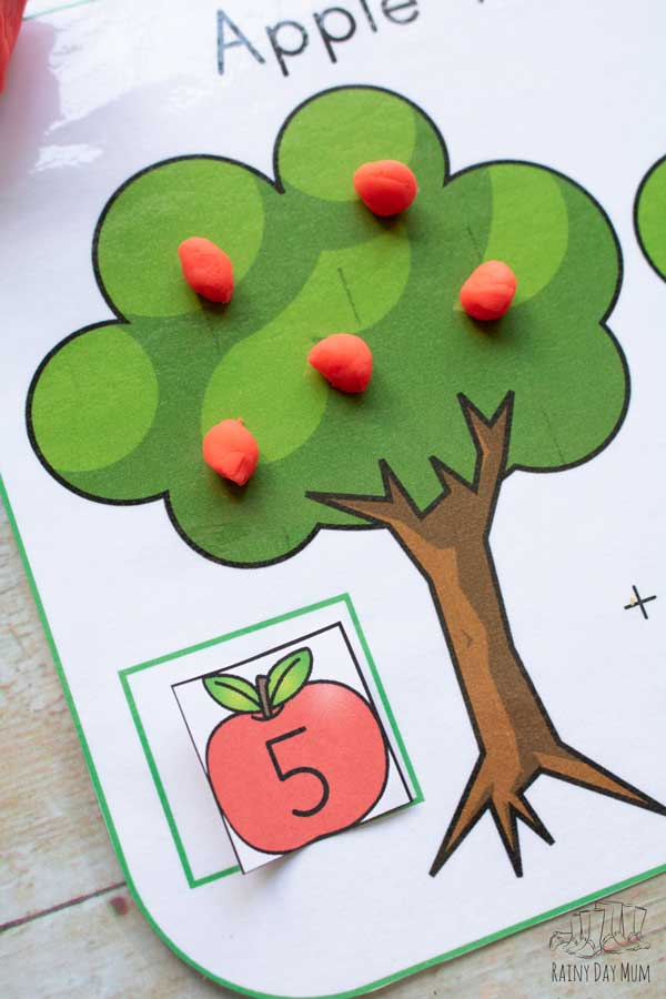5 red apples on the tree showing an apple counting card in place