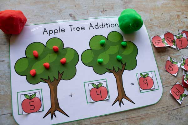 adding the number of apples on the tree made from playdough together in this addition mat for early elementary math