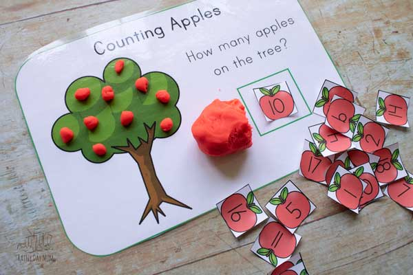 apple playdough mat in use by preschooler