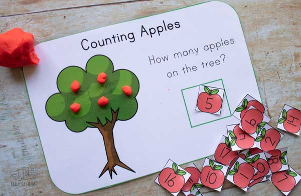 5 red apples on the playdough mat apple tree