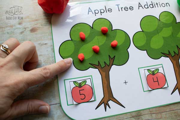 counting out the number of play-doh apples on the tree