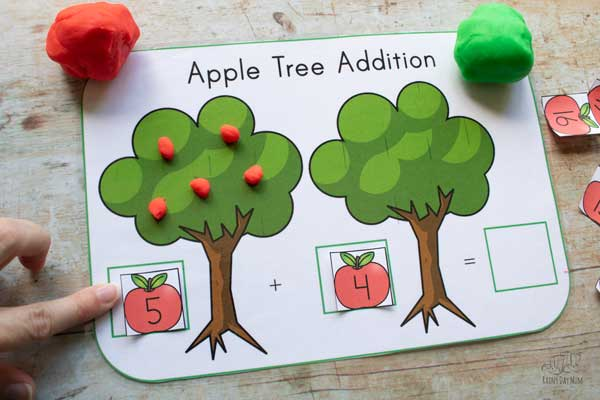 red playdough apples made and counted onto the apple tree on a playdough mat