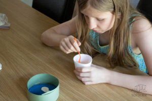 mixing plaster of paris in a plastic cup