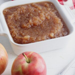 apple with a dish of homemade apple sauce