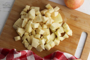 chopped apples on a wooden board