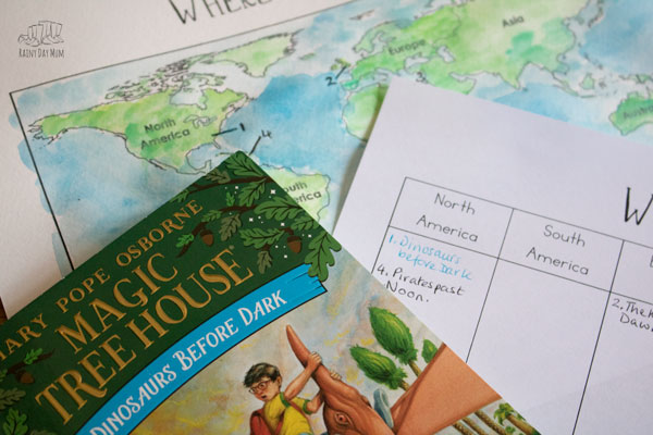 filling in a magic tree house map to accompany the series as we read along
