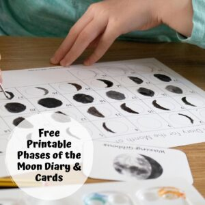 phases of the moon journal being painted by a child at the table