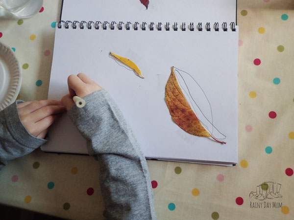 preschooler creating the leaves