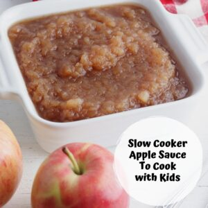 homemade apple sauce in a dish with an apple text overlay reads Slow Cooker apple Sauce to Cook with Kids