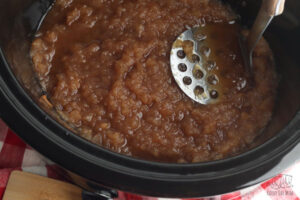 potato masher to get the right consistency in the apple sauce cooked in the slow cooker