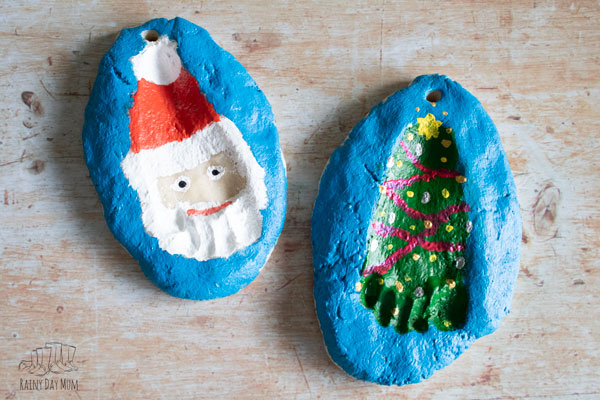 finished painted salt dough footprint Christmas ornaments created during babies first year