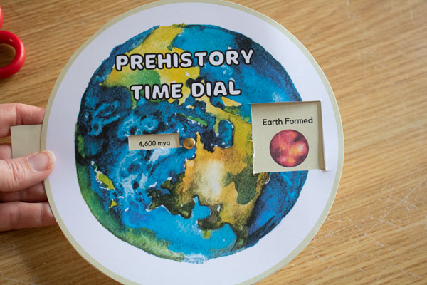 printed and made prehistory time clock showing how many millions of years ago the earth formed