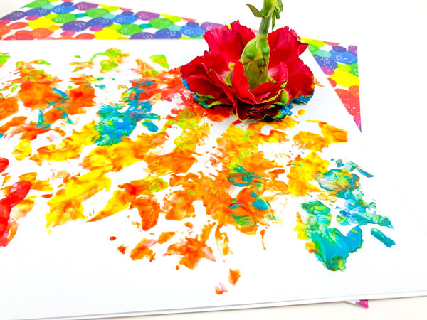 painting with flower on a piece of paper with colourful paints
