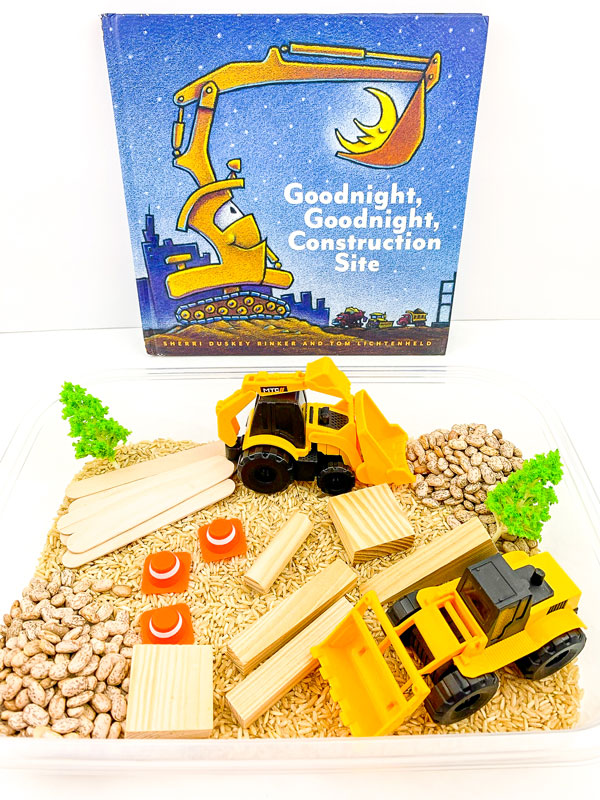 invitation to play, goodnight goodnight construction site themed sensory bin set up with brown rice, pinto beans, trucks and building blocks