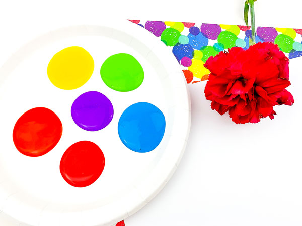 set up for painting with flowers in the spring ideal for toddlers and preschoolers