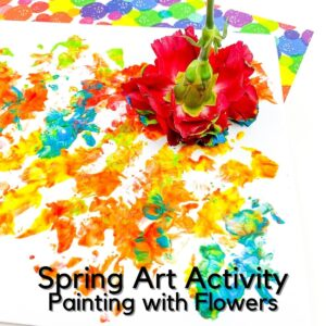 red carnation in paint on a piece of paper painted with bright craft paints created by a child with the flower