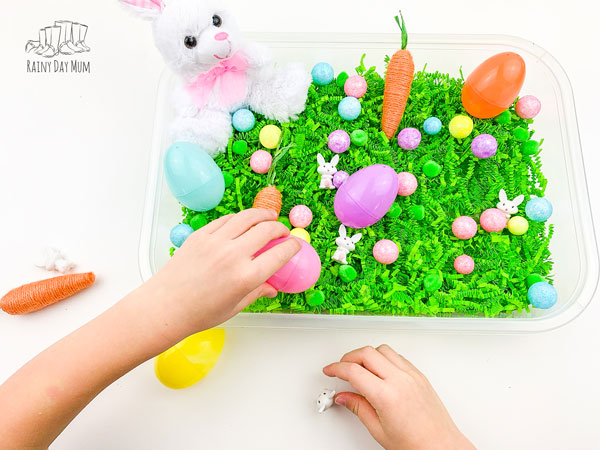 child playing in a spring themed sensory bin