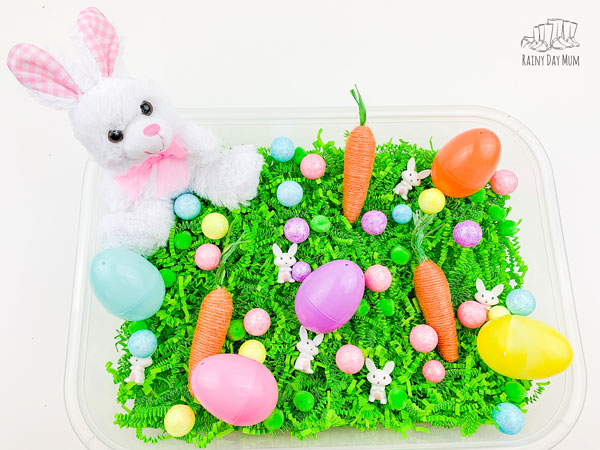 Easter sensory bin set up for a child to explore as an invitation to play