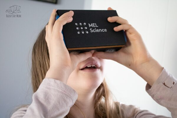 girl using the Mel Science VR headset to supplement the experiments in the monthly subscription box