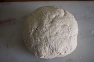 bread dough smooth after kneading on a granite worktop