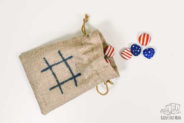 set of painted rock tic tac toe game for the independence day game
