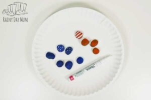 adding stars and stripes to the painted rocks