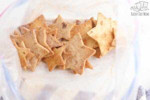 coating tortilla chips in homemade cinnamon sugar in a bag
