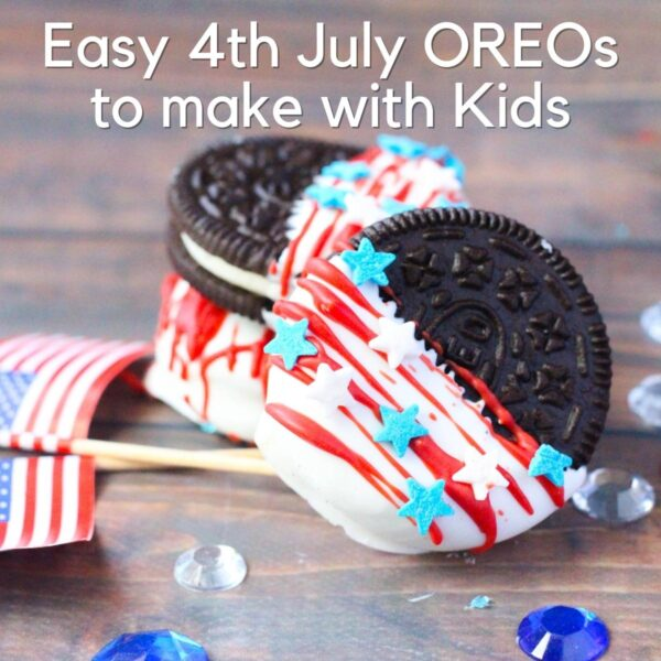 a stack of 3 Oreo Cookies which have been dipped half in white candy-melt, drizzled with red candy melt and star sprinkles added. Placed on a wooden table with a US flad and blue and white gems scattered around text reads Easy 4th July OREOs to make with Kids