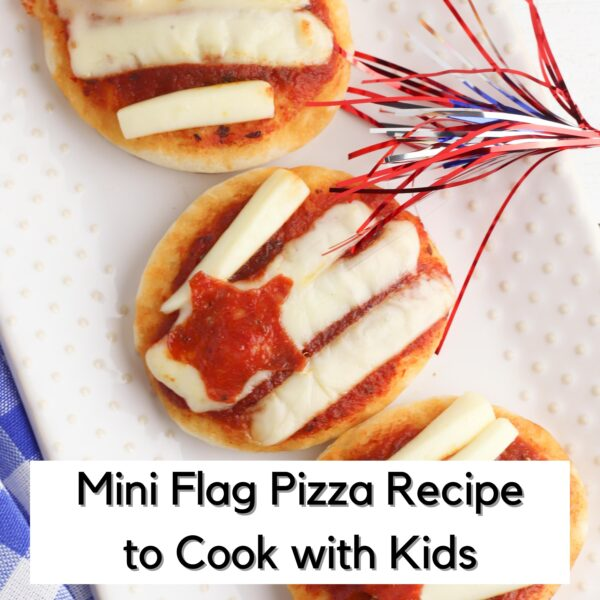 flag pizzas with a sparkler on a white plate text on the image reads mini flag pizza recipe to cook with kids