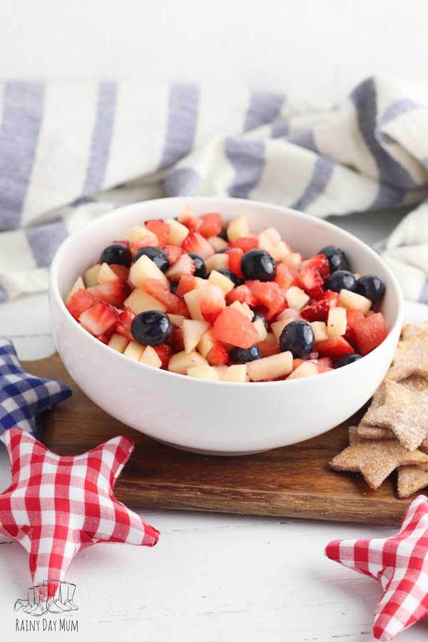 4th of July recipe to cook with kids a delicious and easy red white and blue fruit salad with homemade star shaped cinnamon sugar tortilla chips