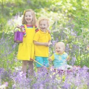 spring kids amongst the bluebells