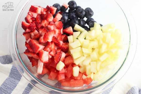 delicious and easy summer fruit salad in red white and blue for patriotic celebrations