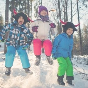 winter kids jumping in the snow