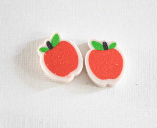 two red apple mini-erasers matched together on a white background
