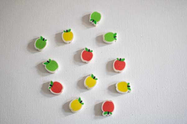 collection and red, green and yellow mini apple erasers from the USA to use in a math activity with toddlers and preschoolers