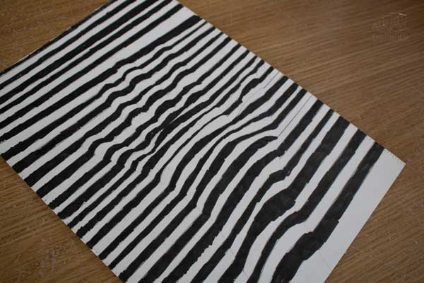 optical illusion drawing of a hand in black and white inspired by the syncopation and art work of Frank Stella